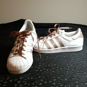 Rose gold and white Adidas Superstars